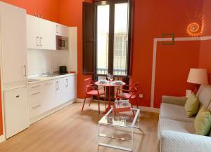 Zona de estar de Ritual Sevilla Suites Centro