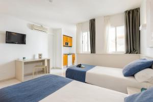 Cama o camas de una habitación en Apartamentos Panoramic