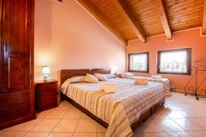 A bed or beds in a room at Residenza La Ricciolina