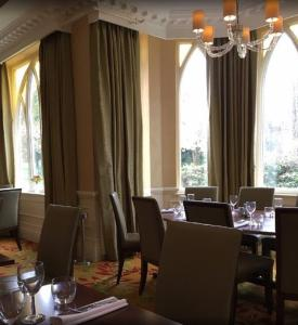 A restaurant or other place to eat at Sprowston Manor Hotel, Golf & Country Club
