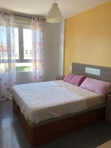 Cama o camas de una habitación en Apartamento Vacacional Aspe