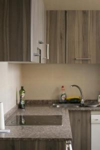 Una cocina o zona de cocina en Apartamento Vacacional Aspe