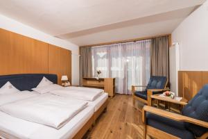 A bed or beds in a room at Family Resort Rainer