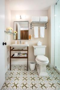 A bathroom at The Savoy Hotel & Beach Club