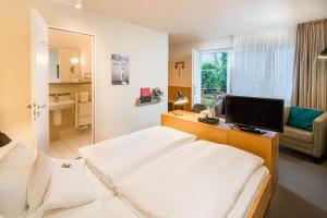 Ein Bett oder Betten in einem Zimmer der Unterkunft Baurs Park