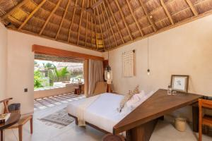 Cama o camas de una habitación en Hotel Ma'xanab Tulum