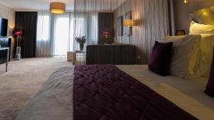 A bed or beds in a room at Luxury Suites Amsterdam - Member of Warwick Hotels
