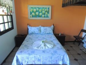 A bed or beds in a room at Pousada Recanto dos Madda's