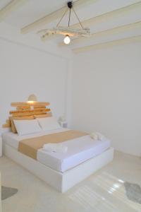 Ένα ή περισσότερα κρεβάτια σε δωμάτιο στο Fantasy Rooms