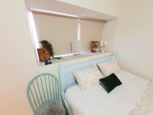 A bed or beds in a room at Sunshine Suite Boutique - Only 5 Min Walk To The Beach