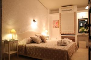Ένα ή περισσότερα κρεβάτια σε δωμάτιο στο Mare Vista Hotel - Epaminondas