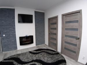 A bed or beds in a room at Noble Home Apartments