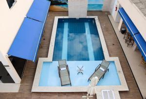 Uma vista da piscina em Pousada Em Cantos do Mundo ou nos arredores
