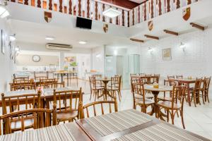 A restaurant or other place to eat at OYO Opala Regente - Campinas Centro