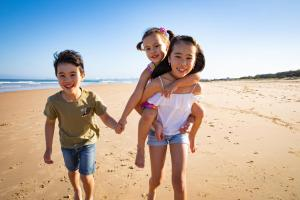 A family staying at Corrimal Beach Tourist Park