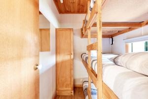 A bunk bed or bunk beds in a room at Torquay Foreshore Caravan Park