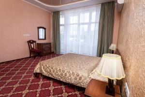 Кровать или кровати в номере Отель Россия