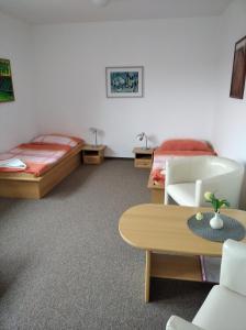 Postel nebo postele na pokoji v ubytování Kulturně Společenské Centrum