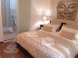 A bed or beds in a room at Albergo Fiera Mare