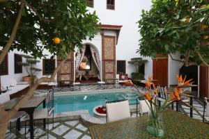 The swimming pool at or near Riad Zineb