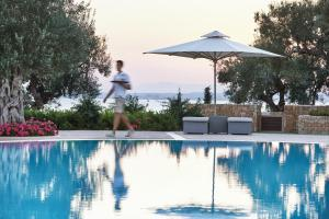 The swimming pool at or near Ikos Olivia