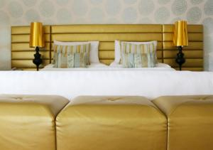A bed or beds in a room at Castle Hotel Macroom