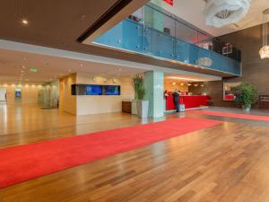 The lobby or reception area at Ramada Sibiu Hotel