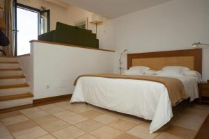 A bed or beds in a room at Finca Atalis - Adults Only