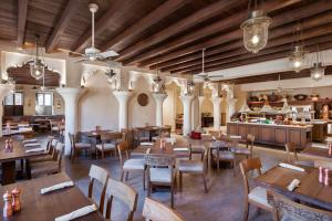A restaurant or other place to eat at Al Seef Heritage Hotel Dubai, Curio Collection by Hilton