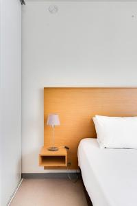 A bed or beds in a room at Residhotel Galerie Tatry