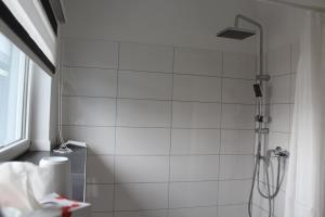 Ein Badezimmer in der Unterkunft Ferienwohnung am Park