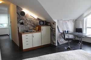 Küche/Küchenzeile in der Unterkunft Ferienwohnung am Park