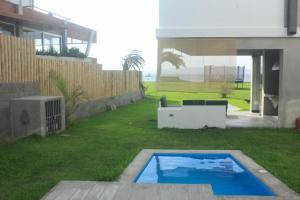The swimming pool at or close to Condominio Los Albatros - Paracas