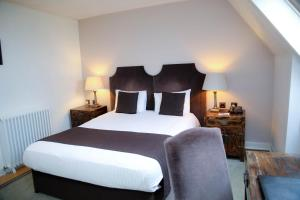 A bed or beds in a room at Shendish Manor Hotel