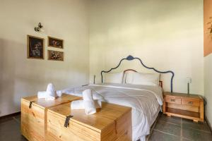 A bed or beds in a room at Selina Paraty