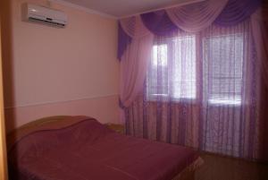 Кровать или кровати в номере Роза Ветров