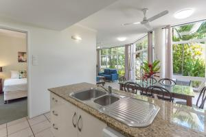 A kitchen or kitchenette at Tropical Nites Holiday Townhouses