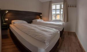 A bed or beds in a room at Country Hotel Anna