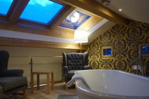 A bathroom at Hotel Walliserhof Zermatt