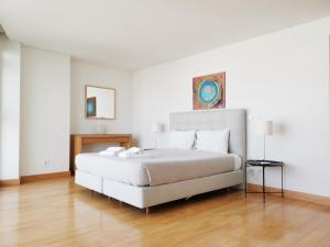 Cama o camas de una habitación en Parque Nacoes Prime Apartments