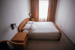 Кровать или кровати в номере Гостиница Балаково