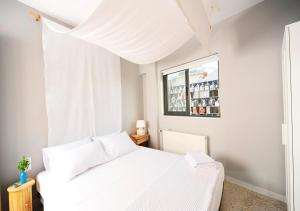 A bed or beds in a room at Live in Athens, PSYRRI Central Apartments