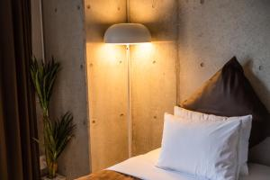 A bed or beds in a room at Condominio Makishi