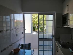 A kitchen or kitchenette at House Almada