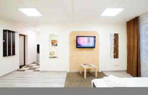 A television and/or entertainment center at Mini-hotel City