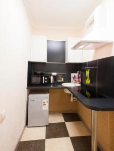 A kitchen or kitchenette at Mini-hotel City
