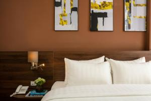 A bed or beds in a room at Viryla Boutique Hotel