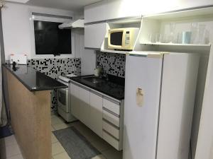 A cozinha ou cozinha compacta de Flat Recreio