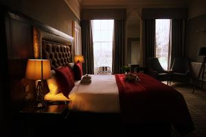 A bed or beds in a room at Culane House Hotel - B&B