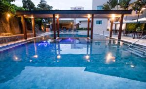 The swimming pool at or near Hotel Morada do Sol